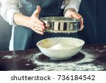 the chef in black apron sifts...   Shutterstock . vector #736184542