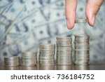 businesswoman puts coins on the ... | Shutterstock . vector #736184752
