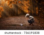 little boy playing with the... | Shutterstock . vector #736191838
