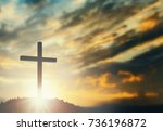 silhouette cross on mountain... | Shutterstock . vector #736196872