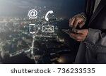 businessman pressing phone... | Shutterstock . vector #736233535