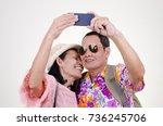 asian senior tourist couple... | Shutterstock . vector #736245706