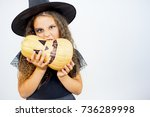 girl in witch costume | Shutterstock . vector #736289998