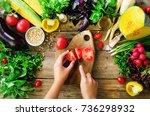 woman hands cutting vegetables... | Shutterstock . vector #736298932