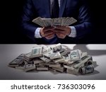 rich business man holding... | Shutterstock . vector #736303096