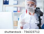 female scientist researcher... | Shutterstock . vector #736323712