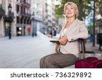 mature female tourist is... | Shutterstock . vector #736329892