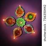 colorful diya during diwali... | Shutterstock . vector #736350442
