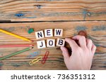 new job. wooden letters on the... | Shutterstock . vector #736351312