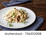 delicious rice with mushrooms... | Shutterstock . vector #736352008