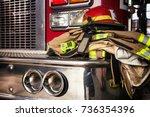 firemen gear on firetruck   Shutterstock . vector #736354396
