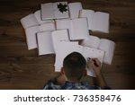man working with book on the... | Shutterstock . vector #736358476