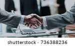 business partners shake hands... | Shutterstock . vector #736388236