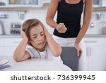 woman scolding her daughter at... | Shutterstock . vector #736399945