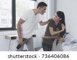 Small photo of Alcoholism is a grief for the family. Mother protects her little dark-haired daughter from a drunken spiteful husband