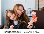 trendy laughing mom in... | Shutterstock . vector #736417762