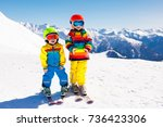 child skiing in the mountains.... | Shutterstock . vector #736423306