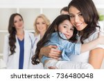 mother and daughter in medical... | Shutterstock . vector #736480048