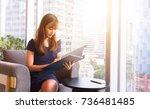 smart professional woman using... | Shutterstock . vector #736481485