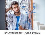 electrician trying to untangle... | Shutterstock . vector #736519522