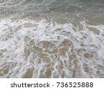 white waves on the beach | Shutterstock . vector #736525888
