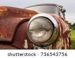 cracked headlight on old rusted ...   Shutterstock . vector #736543756
