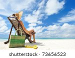 woman on a tropical beach with... | Shutterstock . vector #73656523