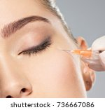 woman getting cosmetic... | Shutterstock . vector #736667086