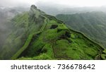 Stock photo hilltop stone bridge ancient fort green nature background aerial view of mountain landscape 736678642