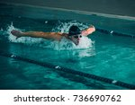 an athletic man swimming fast... | Shutterstock . vector #736690762