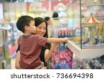 young asian mother and her kid... | Shutterstock . vector #736694398