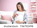 Pregnant Woman Holding Baby...