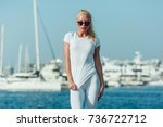 sexy blonde woman in a white t... | Shutterstock . vector #736722712