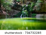 Small photo of Green lake with small waterfall in Butterfly valley on Rhodes island, Greece