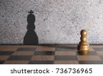 chess king shadow emerging from ... | Shutterstock . vector #736736965