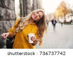stylish happy young woman... | Shutterstock . vector #736737742