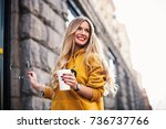 stylish happy young woman... | Shutterstock . vector #736737766