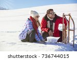 young couple sledding and... | Shutterstock . vector #736744015