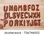 chocolate cookies alphabet on... | Shutterstock . vector #736746052