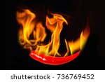 chili pepper in flame on a... | Shutterstock . vector #736769452