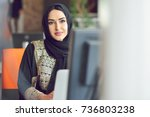 muslim asian woman working in... | Shutterstock . vector #736803238