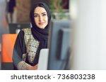muslim asian woman working in... | Shutterstock . vector #736803238