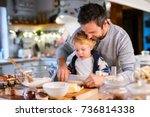 young family making cookies at... | Shutterstock . vector #736814338