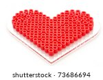 love heart made of decorative plastic beads on a white background - stock photo