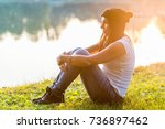 portrait of woman outdoors in a ... | Shutterstock . vector #736897462