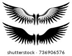 set of wings. | Shutterstock .eps vector #736906576
