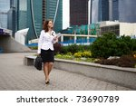 young business woman walking... | Shutterstock . vector #73690789