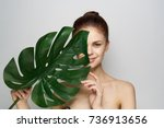 beautiful woman holding a leaf... | Shutterstock . vector #736913656