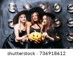 Three Cheerful Young Women In...
