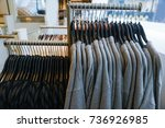 row of female clothes on shop... | Shutterstock . vector #736926985